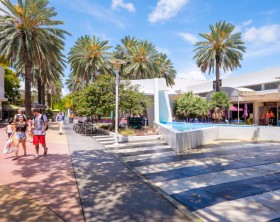 Miami Beach, Florida USA - July 31, 2014: The beautiful Lincoln Road Mall in Miami Beach is a popular international travel destination with palm trees and art deco architecture.