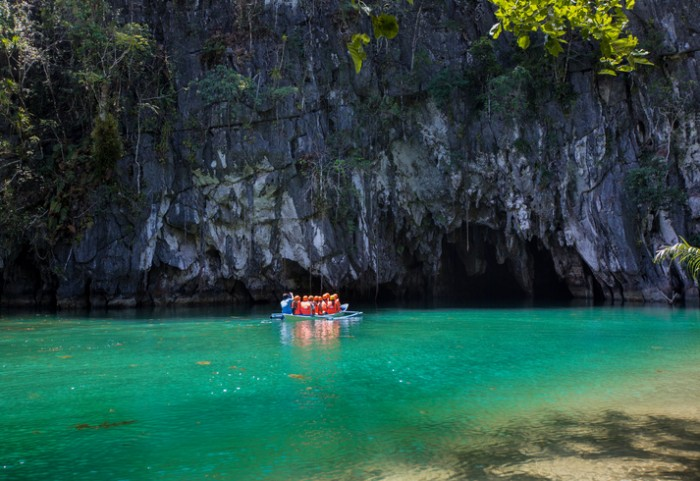 A group of tourists entering the Tabon Cave in Puerto Princesa, Philippines.