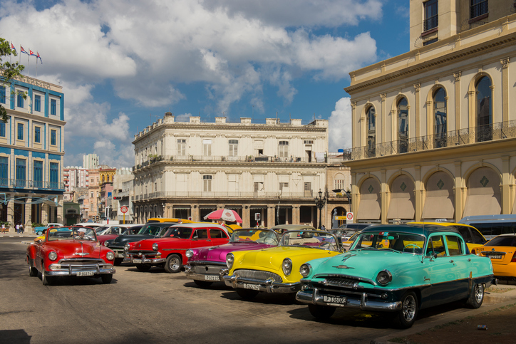 Havana, Cuba - April 10, 2016: Old cars parked at Central Park (Parque Central) at Havana, Cuba, one of the most beautiful square in Havana, Cuba. The city is an Unesco World Heritage site.