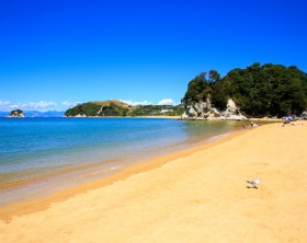 Beautiful orange beaches along the Abel Tasman Great Walk. Kaiteriteri beach. Gateway to Abel Tasman National Park.