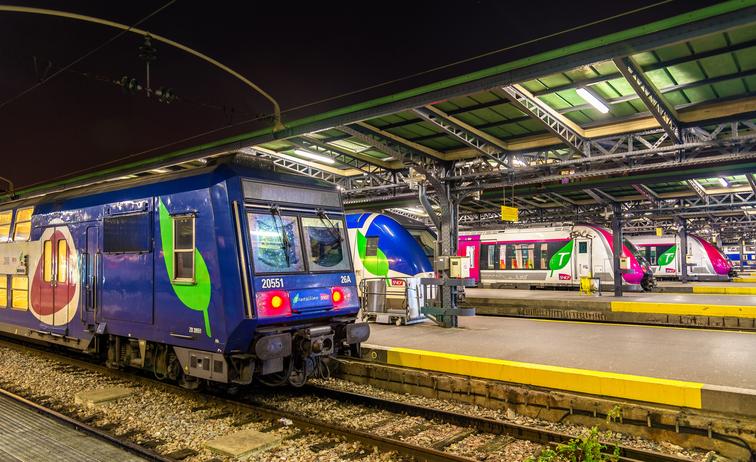 Paris, France - October 9, 2016: Parisian suburban trains Transilien at Paris-Est station. Transilien network transports around 3 million passengers per day