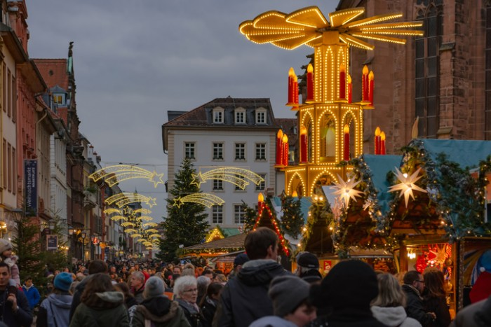 Heidelberg, Germany - December 4, 2016: browsing and shopping at the German traditional Christmas market in the decorated pedestrian area of Heidelberg old town.