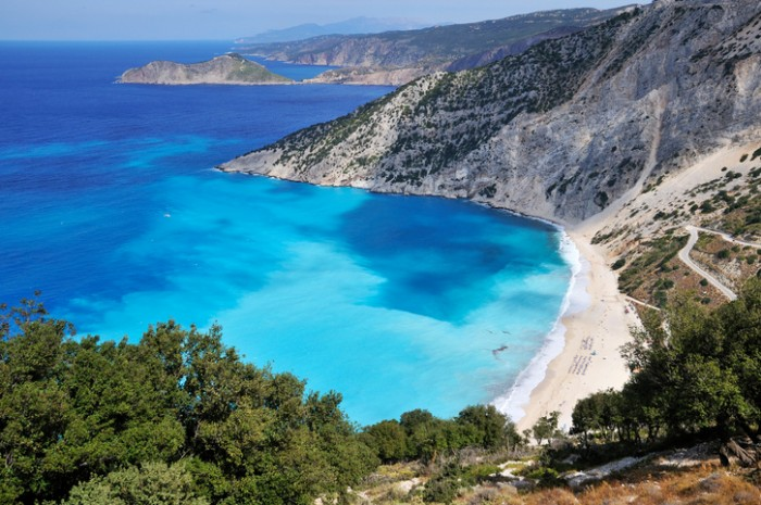 Greek coast with blue water and white beach