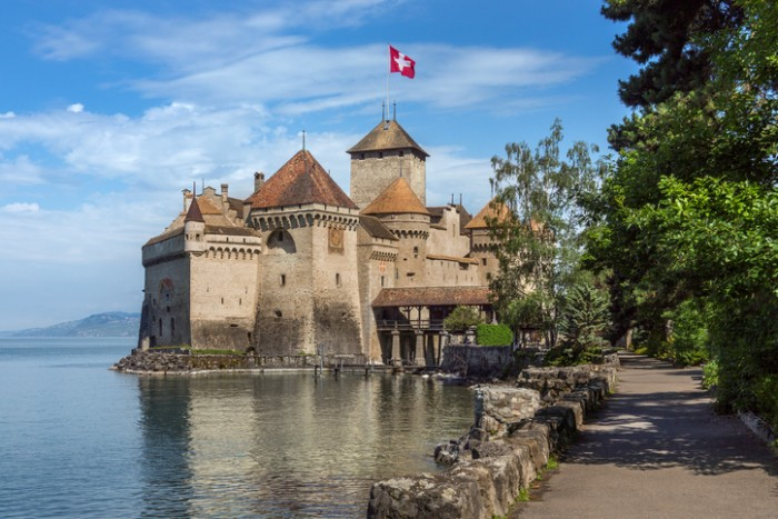 Lake Geneva, Switzerland - June 6, 2012: The medieval castle of Chateau de Chillon on the north shore of Lake Geneva in Switzerland. Parts of the castle date from 1005AD.