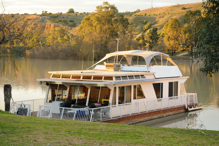 A Houseboat moored on the River Murray at Walker Flat in South Australia at sunset. Selective Focus. Others available in the series.