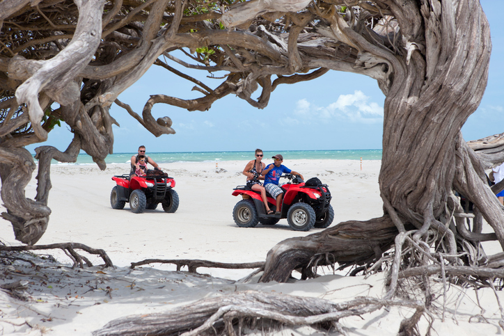 Jericoacoara, Brazil - November 19, 2011: People in ATV cars during an excursion in national park of Jericoacoara, Ceara, Brazil