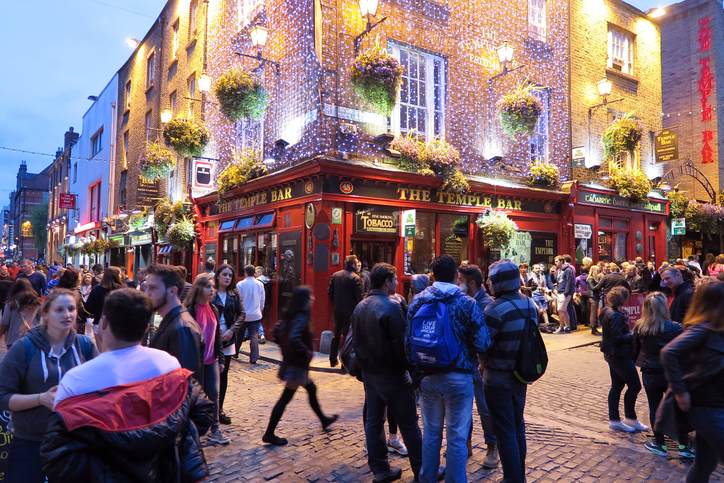 Dublin, Ireland - May 23, 2015:  People gather in front of the Temple Bar in the Temple Bar district the evening that the marriage equality proposal, which authorizes national legalization of gay marriage, was declared passed.  The proposal passed by a margin that surprised most people.