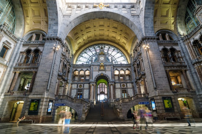 Antwerp, Belgium - May 11, 2015: People in Entrance hall of Antwerp Central station on May 11, 2015 in Antwerp, Belgium. The station is now widely regarded as the finest example of railway architecture in Belgium.
