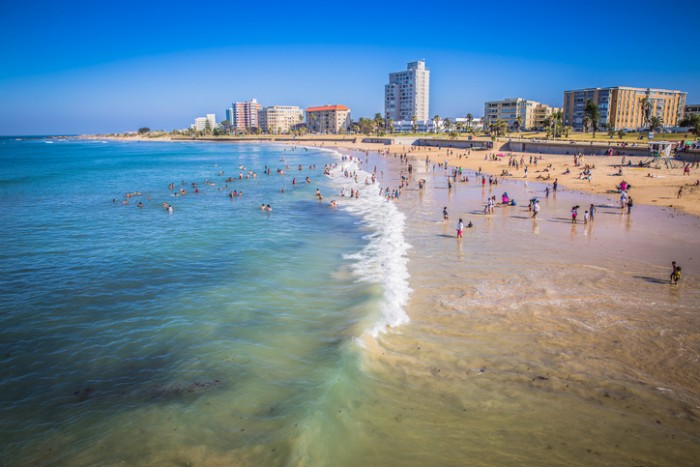 Port Elizabeth, South Africa - January 25, 2015: Port Elizabeth, South Africa - 18 JANUARY 2015, Look at the people on the beach enjoyng the sund at waterfront of Port Elizabeth