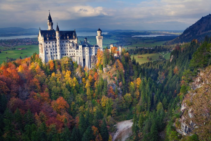 Hohenschwangau, Germany -October 21, 2015: view of Neuschwanstein Castle on October 21th near Hohenschwangau, Germany during autumn sunset.