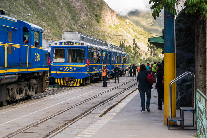Ollantaytambo, Peru - February 4, 2015: Perurail trains are about to take passengers to Machu Picchu Pueblo (formerly Aguas Calientes). This is a cheaper route to get to the Inca's complex than directly from Cusco. Plus, even though it is cheaper, you get to see Ollantaytambo village where a lot of Inca ruins are on the mountains nearby.