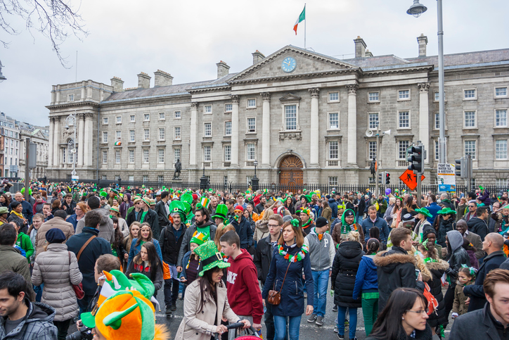 Dublin, Ireland - March 17, 2014: Saint Patrick's Day parade in Dublin, Ireland. On March 17, 2014. People dress up the typical clothes of Saint Patrick's Day at Trinity College on Dame Street