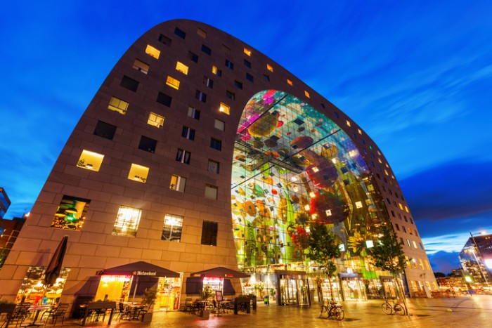 Rotterdam, Netherlands - September 03, 2015: modern market hall in Rotterdam at night. It was opened Oct 1, 2014 by Queen Maxima and designed by architect firm MVRDV. With unidentified people