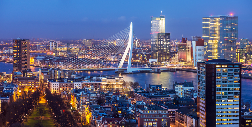 Aerial shot of Rotterdam skyline with Erasmus bridge at twilight as seen from the Euromast tower, The Netherlands