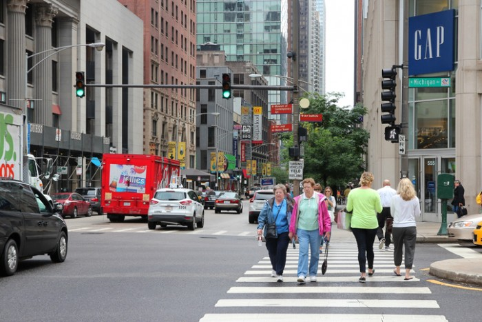 Chicago, United States - June 26, 2013: People walk the famous Magnificent Mile of Michigan Avenue in Chicago. It is Chicago's major shopping destination and one of USA's most recognized shopping areas.