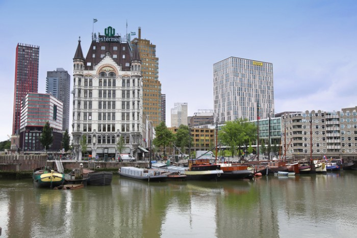 Rotterdam, The Netherlands - August 18, 2015: Rotterdam is a city modern architecture, Westermeijer Tower and Oude Haven oldest part of the harbour in Rotterdam, Netherlands.