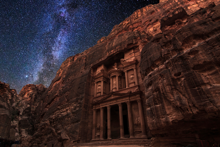 Ancient Petra on the background of the night starry sky. Jordan.