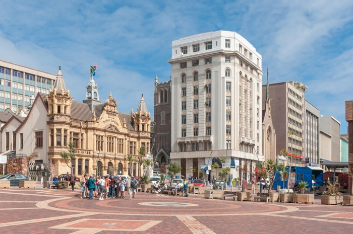 Port Elizabeth, South Africa - February 27, 2016: Unidentified tourists at the historic Market Square in Port Elizabeth. Several historic buildings are visible