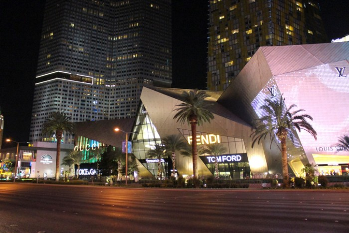 Las Vegas, NV, United States - October 22, 2014: View of the Gucci, Fendy, Tiffany & co, Fendi and Louis Vuitton Stores illuminated at night with Mandarin hotel on background. These Stores are some of the most famous on Las Vegas Strip.