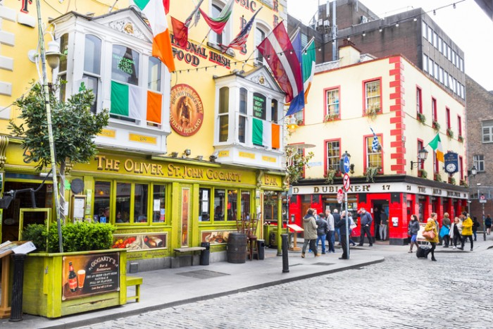 Dublin, Ireland - May 5, 2016: Tourists walking in the Temple Bar area.