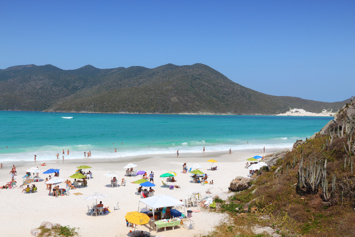 Cabo Frio, Brazil - October 17, 2014: People visit Cabo Frio Prainhas beach in state of Rio de Janeiro in Brazil. Brazil had 5.17 million visitors in 2012.