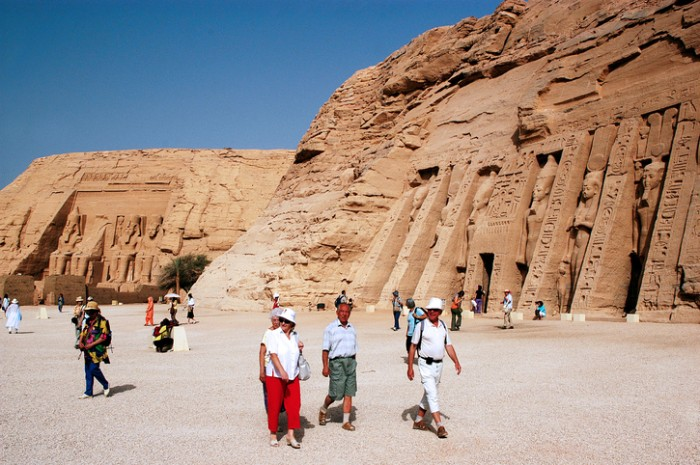 ABU SIMBLE - APRIL 29: Visitor at the Great Temple of Abu Simbel on the border of Egypt and Sudan on April 29 2007.The number of tourists visiting Egypt dropped by more than a third since the Egyptian revolution on Jan 25 2011.