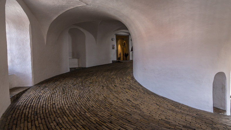 Сopenhagen, Denmark - April 19, 2016: The spiral staircase ramp inside the round tower is one of the most popular sights in Copenhagen. It was built by King Christian IV in 1642 as an observatory and was built until 1861 for scientific purposes. What makes the Round Tower is that it has no stair. The course is 209 meters long in total, at the end is a viewing platform in 35 meters height from which it has a great view over the houses of the old city and all Copenhagen. Rundetårn, Copenhagen, Denmark.