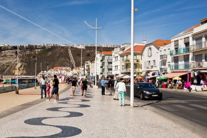 Nazare, Portugal - September 12, 2016: View of the very popular with tourists beachfront avenue in the fishing village of Nazare