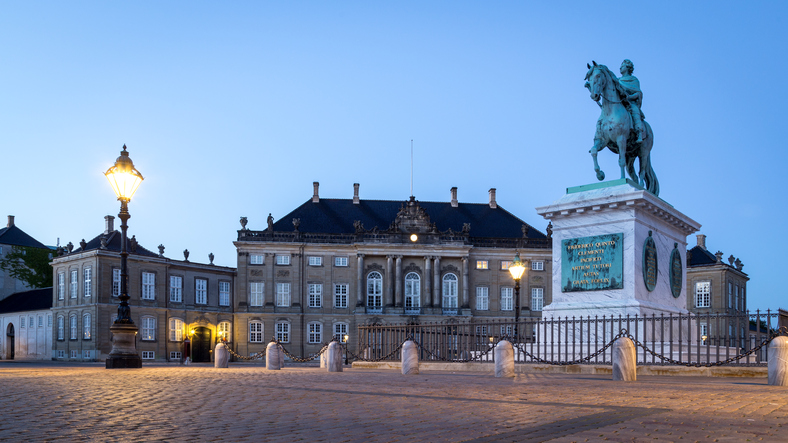 Copenhagen, Denmark - June 05, 2016: Evening photography of Amalienborg Palace and the statue of Frederik V