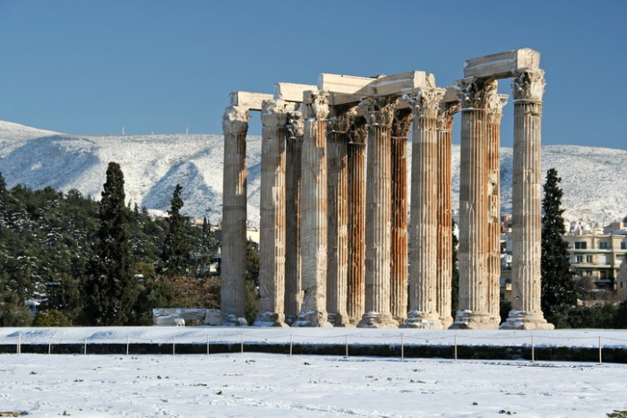 The ancient temple of Olympian Zeus in Athens, Greece, after a snowfall
