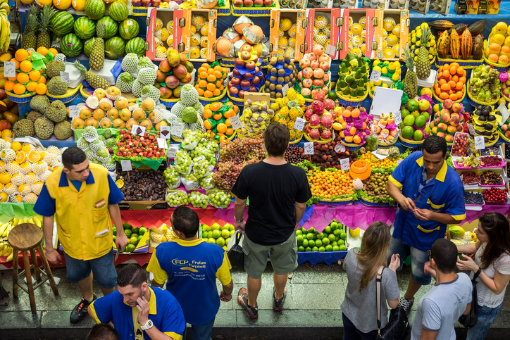 Sao Paulo, Brazil - March 14, 2015: People grocery shopping at the traditional Municipal Market (Mercado Municipal) in Sao Paulo, Brazil.