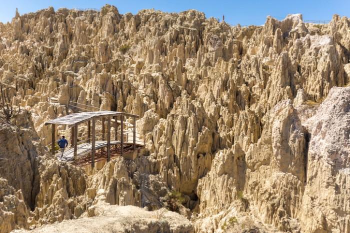 Unique geological formations cliffs shapes, Moon Valley park, La Paz mountains, Bolivia tourist travel destination.