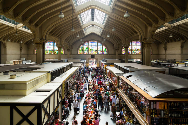 Sao Paulo, Brazil - March 15, 2014: People visiting the famous Municipal Market (Mercado Municipal) in Sao Paulo. Its a huge and bustling market with local fruit, vegetable, spice or condiment you could ask for.