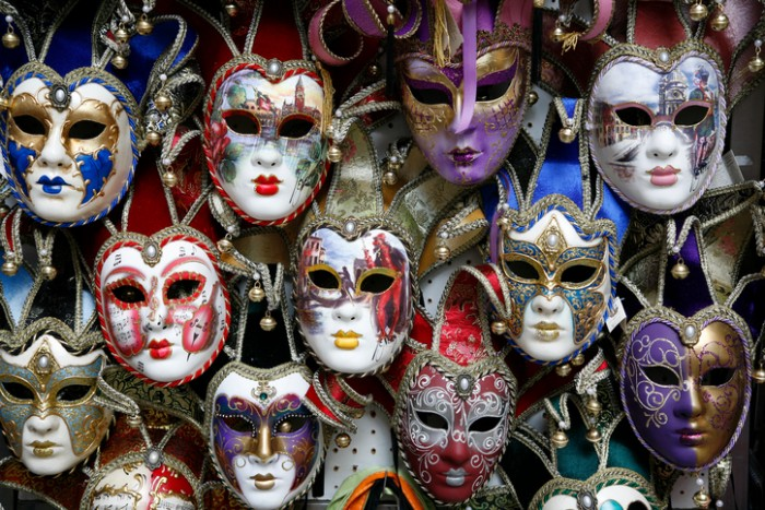Beautiful carnival masks - Venice, Italy displayed on black.