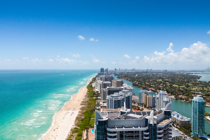 View of Miami facing south from Collins and 63rd with South Beach on the left and the city on the right.