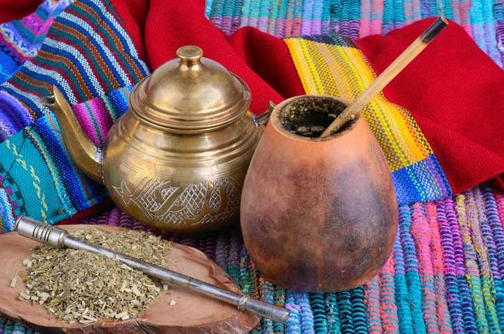 Cup from calabash and teapot with dry mate leaves.Traditional drink of Peru, Brazil and Argentina.