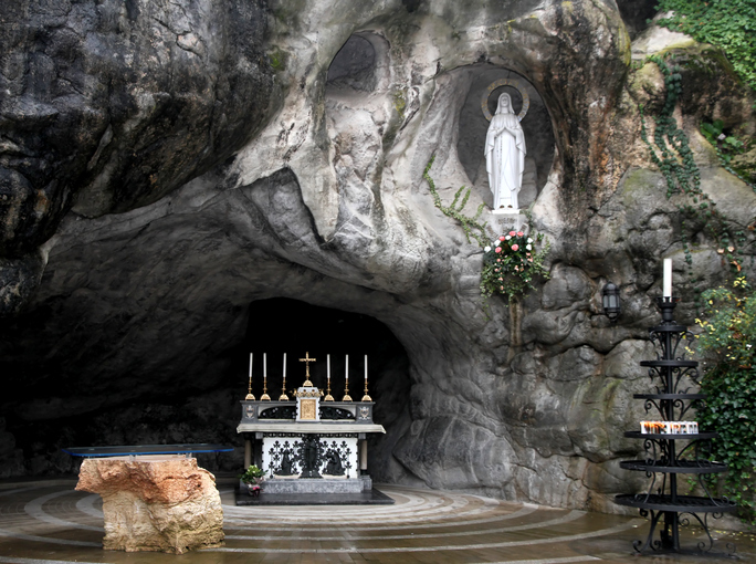 Statue of the Virgin Mary in the grotto of Lourdes attracts many pilgrims from all over the world 1