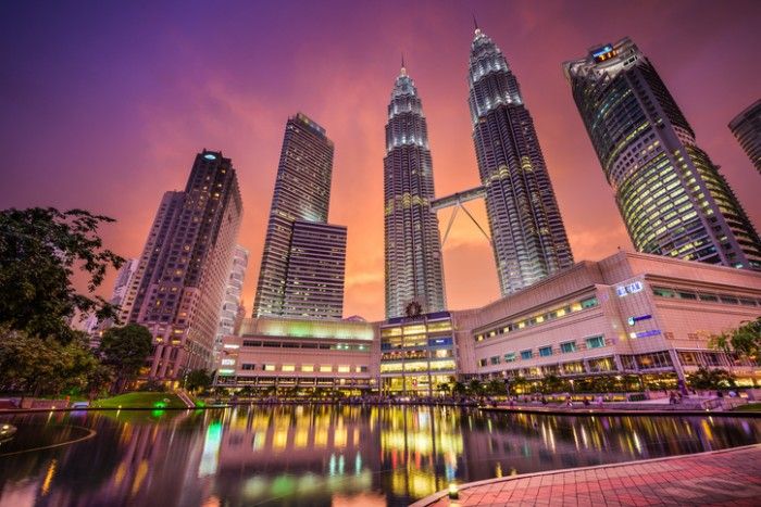Kuala Lumpur, Malaysia - September 20, 2015: KLCC Park and Petronas Twin Towers at sunset. They are the tallest Twin Towers in the World.