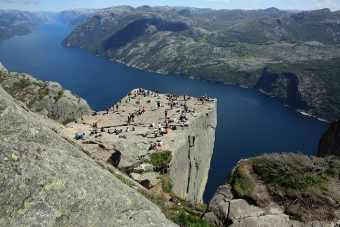 Preikestolen, Norway - June 16, 2014: Pulpit Rock (Preikestolen) is one of the most favourite attractions in Norway. Its a rock 600m above the Lysefjord. During the Summer there are a lot of people there - local people and tourists.