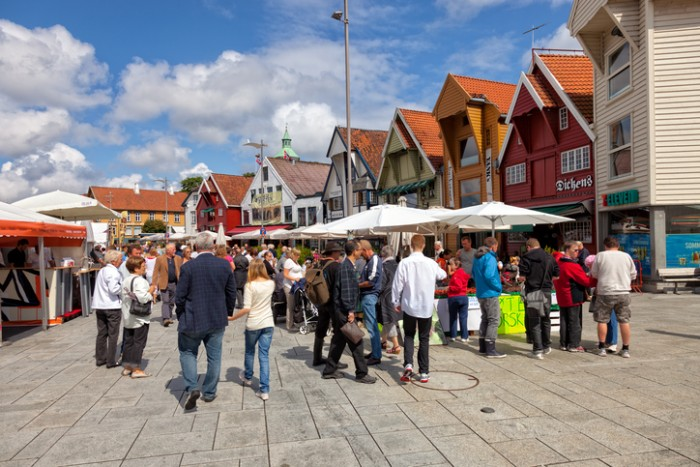 Stavanger, Norway - July 20, 2011: Lot of Tourists walking, shopping and sightseeing in Stavanger, Norway.  Stavanger is one of most famous cruise travel destinations in Europe.