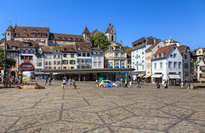 Basel, Switzerland - 27 August, 2016: buildings and people on Barfuesserplatz square. Basel is a city on the Rhine river in northwestern Switzerland, situated where the Swiss, German and French borders meet.