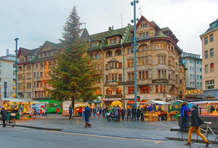 Basel, Switzerland - January 3, 2014: Street view of Marktplatz in the Old City of Basel. Basel is a third most populous city in Switzerland. It is located on the river Rhine. People on the square.