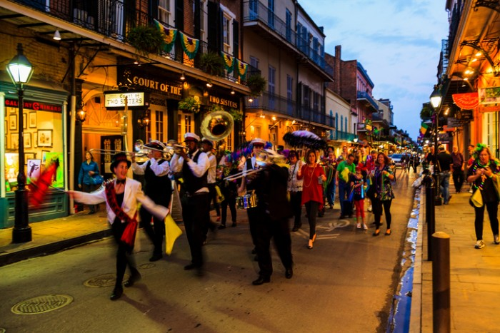 New Orleans USA  Feb 2 2016:Visitors and locals are all over in the French Quarter's  streets of New Orleans. People are celebrating and partying  while enjoying the street music. This is an ongoing life style .  There are a lot of talented artists in the city.
