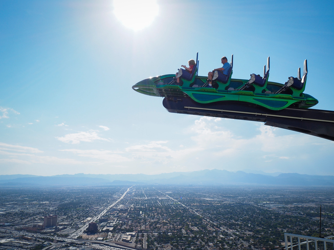 "Las Vegas, NV - 28 July 2016: Tourists sit inside a cart of the thrill ride ""X-Scream"" on top of the Las Vegas Stratosphere tower (1149 ft/350m), the tallest freestanding observation tower of the US."