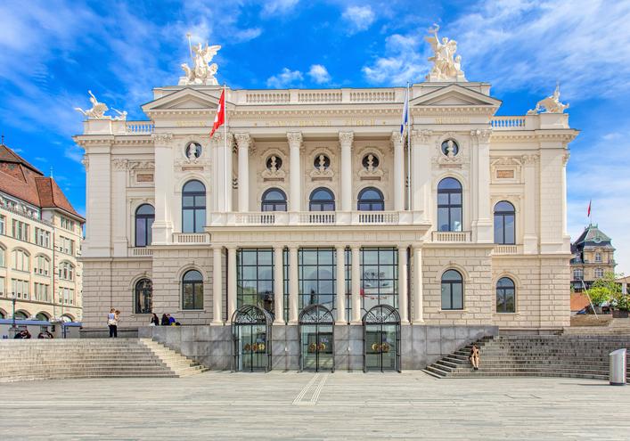Zurich, Switzerland - 25 May, 2016: Zurich Opera House building facade, people in front of it. Zurich Opera House (German: Opernhaus Zurich) has been the home of the Zurich Opera since 1891. It also houses the Bernhard-Theater Zurich and the Zurich Ballet.