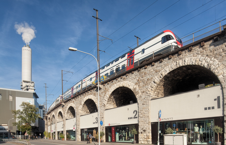 Zurich, Switzerland - 28 September, 2014: train passing the Viaduct. Zurich is the largest city in Switzerland and the capital of the canton of Zurich.