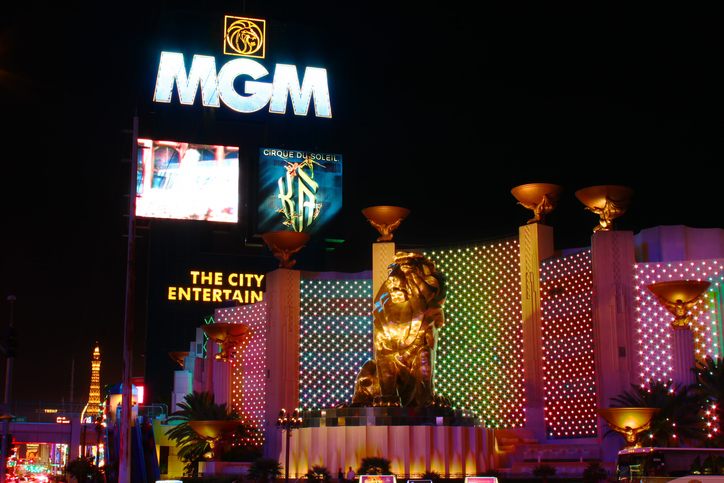 """Las Vegas, USA - October 29, 2011: The MGM Grand Las Vegas is one of the largest hotels in the world.  The main sign on Las Vegas Boulevard and the bronze Leo the Lion statue are seen here."""