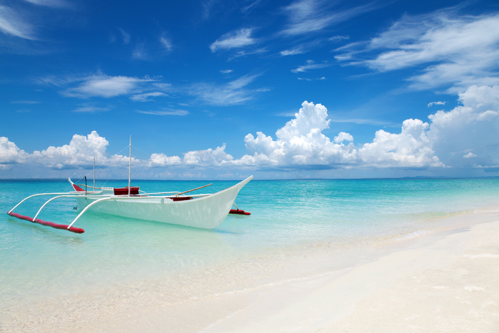 White boat on tropical Bantayan island in Philippines