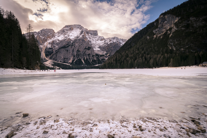 Winter scenery of frozen lake Braies at Dolomites alps, Italy.