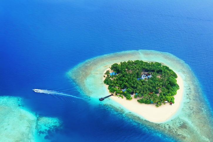 Small tropical island in the ocean, Maldives. Shot was taken from seaplane.